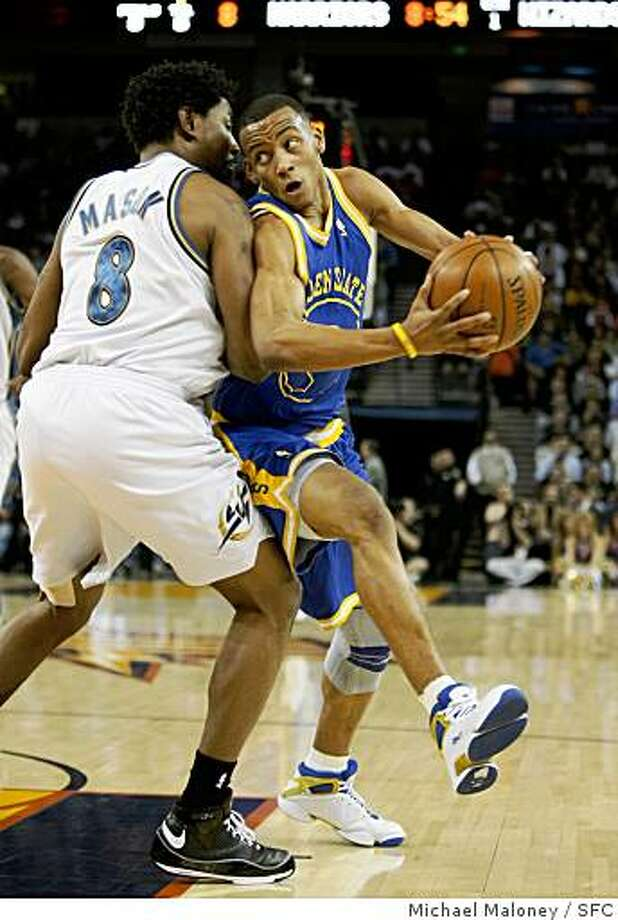 Golden State Warriors Monta Ellis (8) looks for some room around Washington Wizards Roger Mason (8) in the 1st half.The Golden State Warriors host the Washington Wizards at Oracle Arena in Oakland, CA on Monday, February 11. 2008.Photo by Michael Maloney / The Chronicle Photo: Michael Maloney, SFC