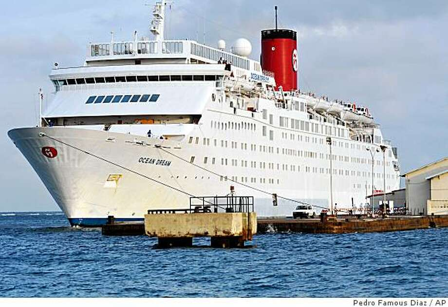The cruise ship Ocean Dream sits at the dock, in Orangestad, on the Dutch Antilles island of Aruba, Friday, June 19, 2009. The cruise ship, which was hit by a swine flu outbreak while at sea, arrived back at it's home port and was met by teams of masked medical workers as health authorities tried to prevent the illness from spreading. (AP Photo/Pedro Famous Diaz) Photo: Pedro Famous Diaz, AP
