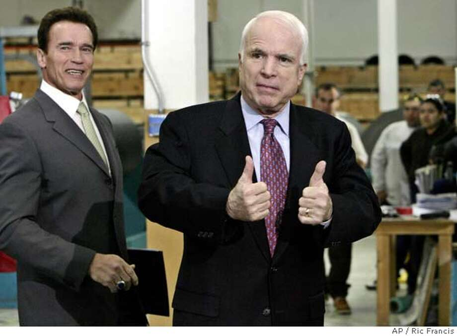 California Gov. Arnold Schwarzenegger, left, looks on as Republican presidential hopeful, Sen. John McCain, R-Ariz., right, gives a thumbs-up as they depart a news conference in Los Angeles, Thursday, Jan. 31, 2008, where Schwarzenegger endorsed McCain. (AP Photo/Ric Francis) Photo: Ric Francis