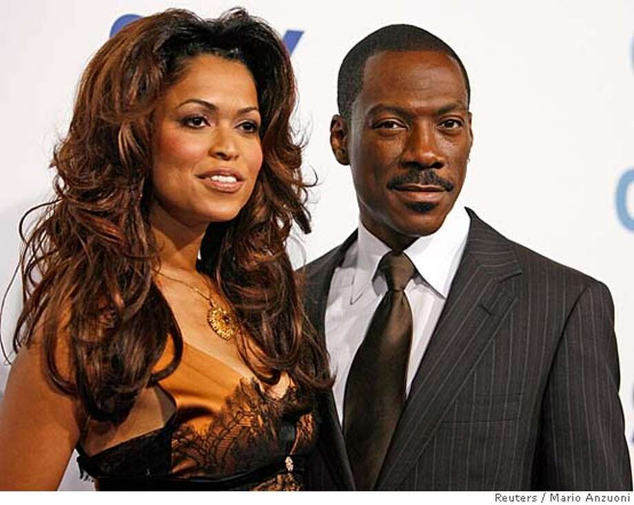 """Actor Eddie Murphy poses with actress Tracey Edmonds at the premiere of """"Good Luck Chuck"""" at the Mann National theatre in Westwood, California, in this September 19, 2007 file photo. The couple have split up just two weeks after their wedding in French Polynesia, People magazine reported on January 16, 2008. REUTERS/Mario Anzuoni/Files (UNITED STATES) 0 Photo: MARIO ANZUONI"""