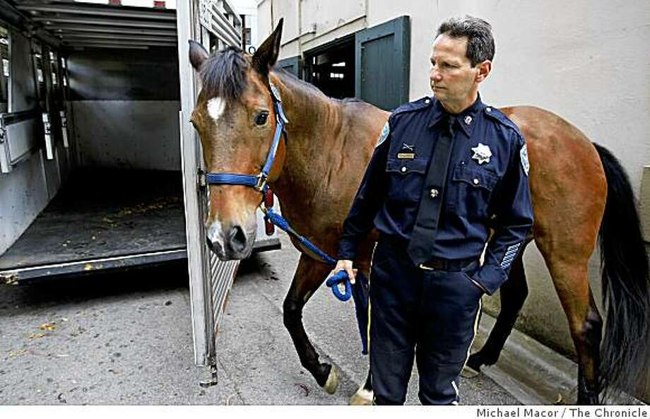 "Officer Steve Marquez, holds ""Kenny"" which her rode for the past 5 years as part of the San Francsico Police Mounted Unit. The horse was retired today, on Tuesday June 15, 2009 in  San Francisco after 12 years of service along with another, ""Chip"" who was with the department for 10 years. Photo: Michael Macor, The Chronicle"
