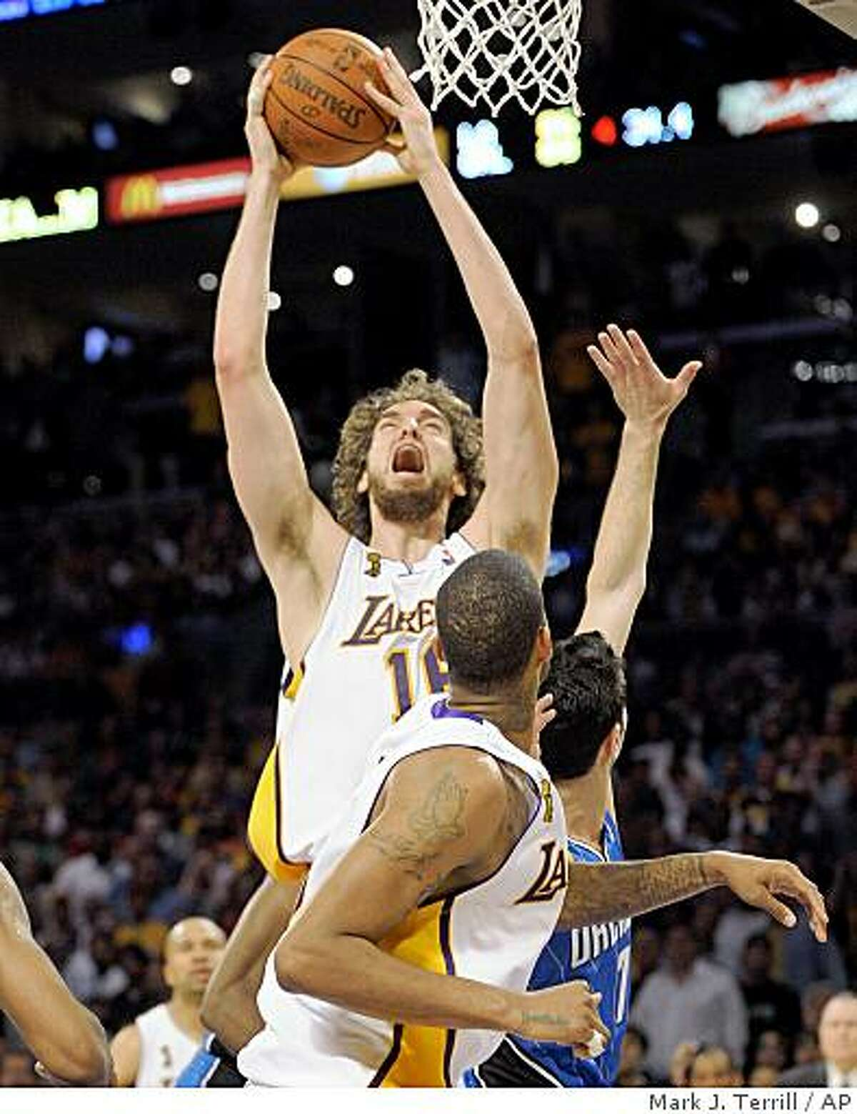 Los Angeles Lakers forward Pau Gasol (16) of Spain, puts up a key shot in the final seconds of the second half of Game 2 of the NBA basketball finals against the Orlando Magic Sunday, June 7, 2009, in Los Angeles. The Lakers went on to win 101-96 in overtime. (AP Photo/Mark J. Terrill)
