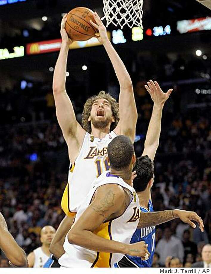 Los Angeles Lakers forward Pau Gasol (16) of Spain, puts up a key shot in the final seconds of the second half of Game 2 of the NBA basketball finals against the Orlando Magic Sunday, June 7, 2009, in Los Angeles.  The Lakers went on to win 101-96 in overtime. (AP Photo/Mark J. Terrill) Photo: Mark J. Terrill, AP