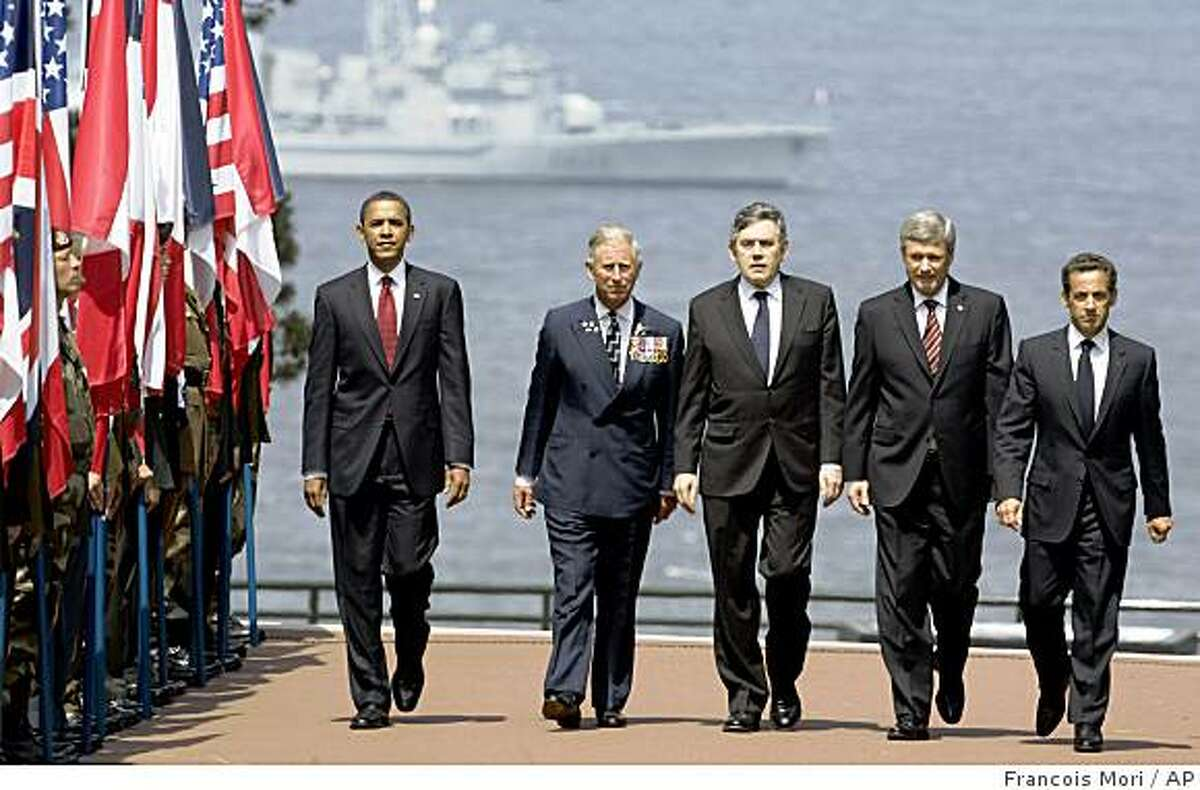 From left, U.S. President Barack Obama, Britain's Prince Charles, British Prime Minister Gordon Brown, Canadian Prime Minister Stephen Harper, and French President Nicolas Sarkozy arrive at the American Cemetery at Colleville-Sur -Mer, near Caen, Western France, Saturday, June 6, 2009 to attend the 65th Anniversary of the D-day landings in Normandy. (AP Photo/Francois Mori)