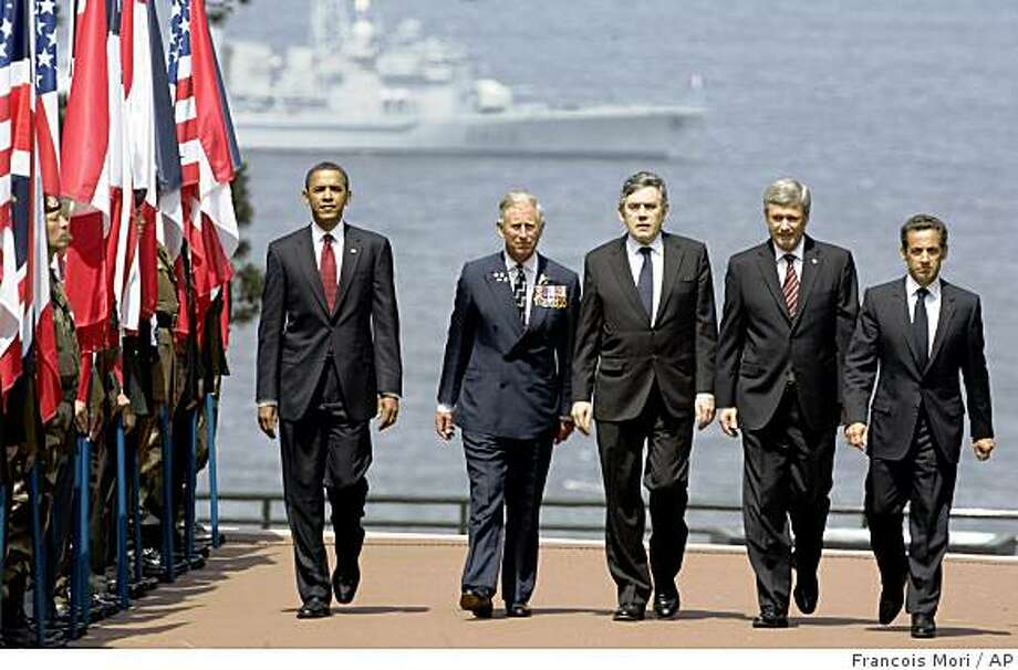 From left, U.S. President Barack Obama, Britain's Prince Charles, British Prime Minister Gordon Brown, Canadian Prime Minister Stephen Harper, and French President Nicolas Sarkozy arrive at the American Cemetery at Colleville-Sur -Mer, near Caen, Western France, Saturday, June 6, 2009 to attend the 65th Anniversary of the D-day landings in Normandy. (AP Photo/Francois Mori) Photo: Francois Mori, AP