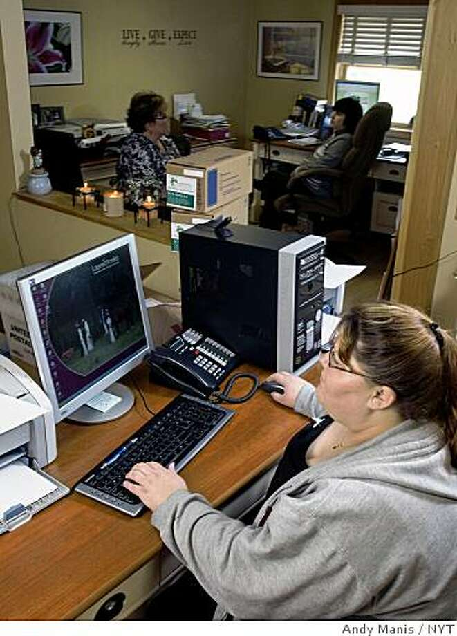 Victoria Bench at work on her computer at the Cistercian Abbey of  Our Lady of Spring Bank in Sparta, Wisc., on May 28, 2009. Bench is the office manager of the monastery's business. (Andy Manis/The New York Times) Photo: Andy Manis, NYT