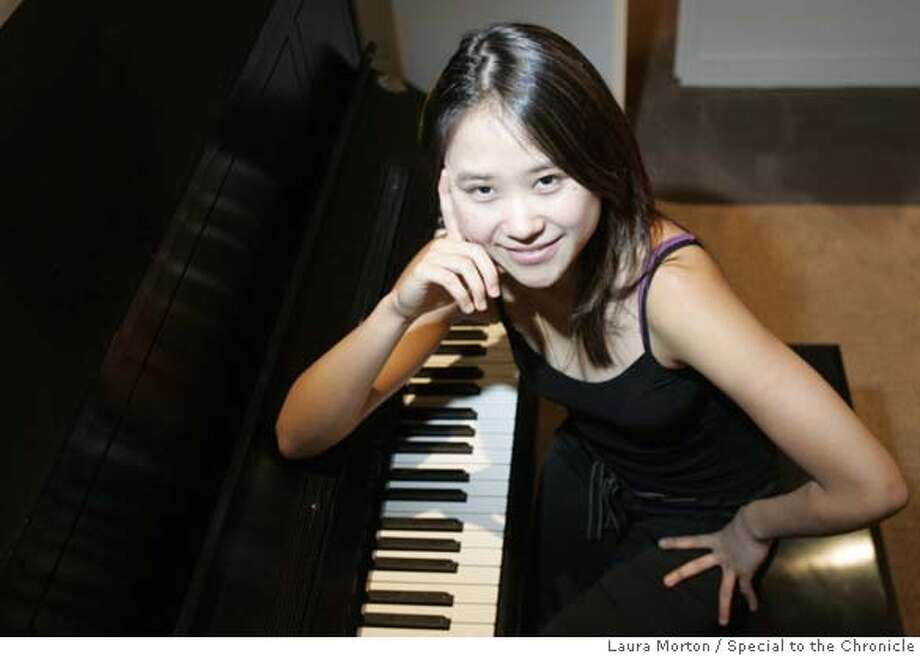 Yuja Wang is a 19-year-old pianist who lives in Philadelphia, PA. **NOTE: info in photo request about age and home was wrong. Also be sure to check age again because by the time of this publication her age could change. Ran on: 04-14-2007  Yuja Wang, 20, on her impressive repertoire: &quo;It keeps me from being bored.&quo; MANDATORY CREDIT FOR PHOTOGRAPHER AND SAN FRANCISCO CHRONICLE/NO SALES-MAGS OUT Photo: Laura Morton