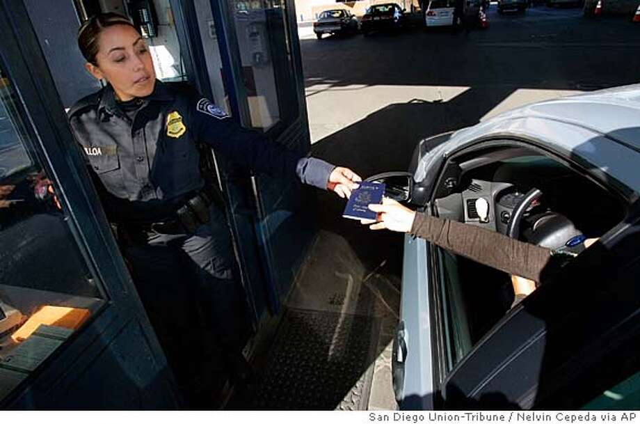 At the San Ysidro Port of Entry, U.S Customs and Border Protection officer, Sandra Ulloa checks the identification and passport documents of a passenger vehicle crossing from Mexico into the United States, Thursday, Jan. 31, 2008. (AP Photo/ San Diego Union-Tribune, Nelvin Cepeda) ** NO SALES, ONLINE OUT, NO ARCHIVING, SAN DIEGO COUNTY OUT, TV OUT, MAGS OUT, NO FORNS. TABLOIDS OUT. WIDE WORLD OUT. COMMERCIAL INTERNET USE OUT ** NO SALES, ONLINE OUT, NO ARCHIVING, SAN DIEGO COUNTY OUT, TV OUT, MAGS OUT, NO FORNS. TABLOIDS OUT. WIDE WORLD OUT. COMMERCIAL INTERNET USE OUT Photo: Nelvin C. Cepeda