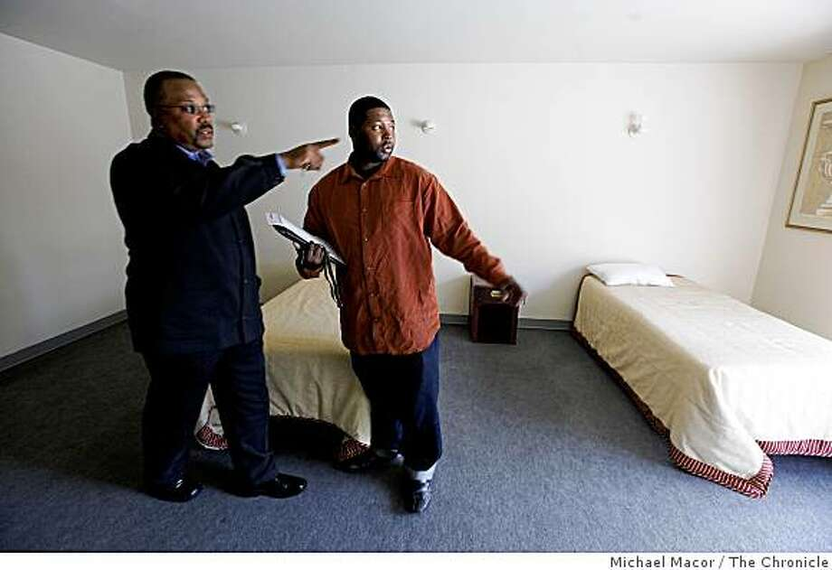 Sam Manning, (left) Director of transitional housing for the company and Lamar Graves, in Oakland, Calif. on Thursday June 4, 2009. Graves, a man who has spent time in jail is now employed at RMD Services 1, a property management firm in Oakland, where he is the office manager. The two at Israelite Community Life Facility, one of the properties the company owns at Foothill and 35th Ave. in Oakland, which has 28 rooms for rent. Photo: Michael Macor, The Chronicle