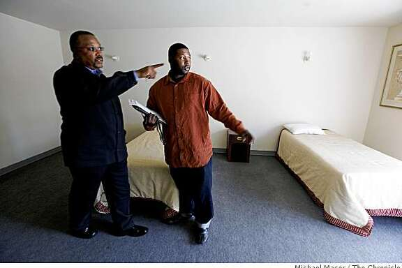 Sam Manning, (left) Director of transitional housing for the company and Lamar Graves, in Oakland, Calif. on Thursday June 4, 2009. Graves, a man who has spent time in jail is now employed at RMD Services 1, a property management firm in Oakland, where he is the office manager. The two at Israelite Community Life Facility, one of the properties the company owns at Foothill and 35th Ave. in Oakland, which has 28 rooms for rent.