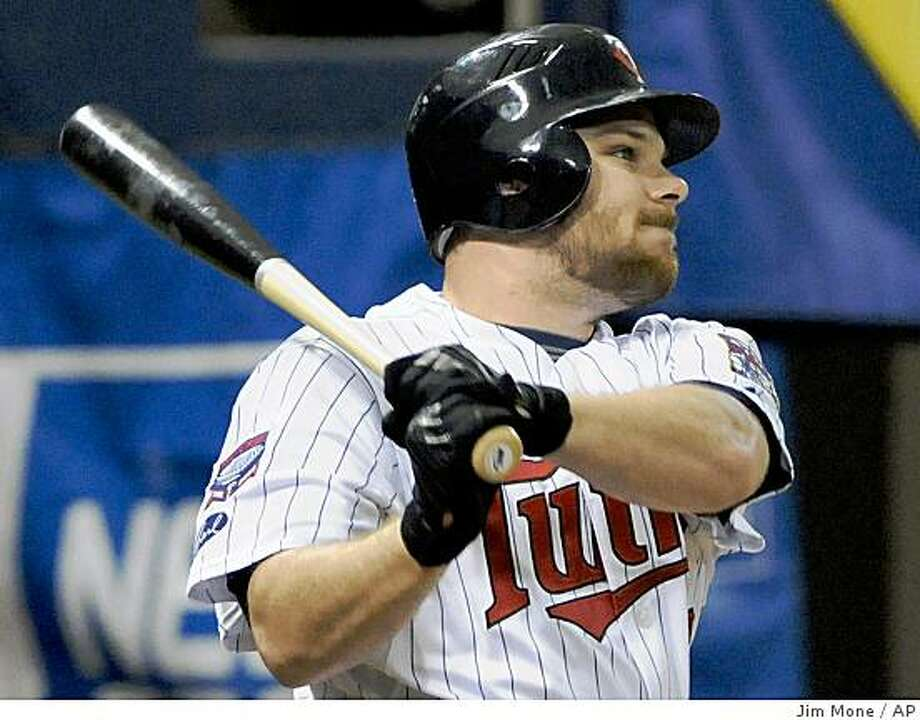 Minnesota Twins' Jason Kubel hits the second of two three-run home runs off  Cleveland Indians' Fausto Carmona in the second inning of a baseball game, Thursday, June 4, 2009 in Minneapolis. Kubel hit the other three-run homer in the first inning. The Twins won 11-3. (AP Photo/Jim Mone) Photo: Jim Mone, AP