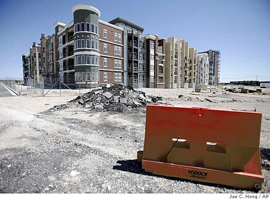 FILE - In this May 8, 2009 file photo, Manhattan West, a stalled condominium project, stands unfinished behind a fence in Las Vegas.  (AP Photo/Jae C. Hong, File) Photo: Jae C. Hong, AP