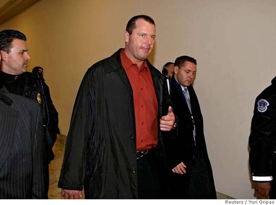Major League Baseball pitcher Roger Clemens arrives for a meeting with Rep. Paul Kanjorski (D-PA) on Capitol Hill in Washington February 8, 2008. Clemens dismissed as bogus on Thursday new claims of evidence by his former trainer -- including needles and bloody gauze pads -- that Clemens used performance-enhancing drugs. REUTERS/Yuri Gripas (UNITED STATES) 0 Photo: YURI GRIPAS