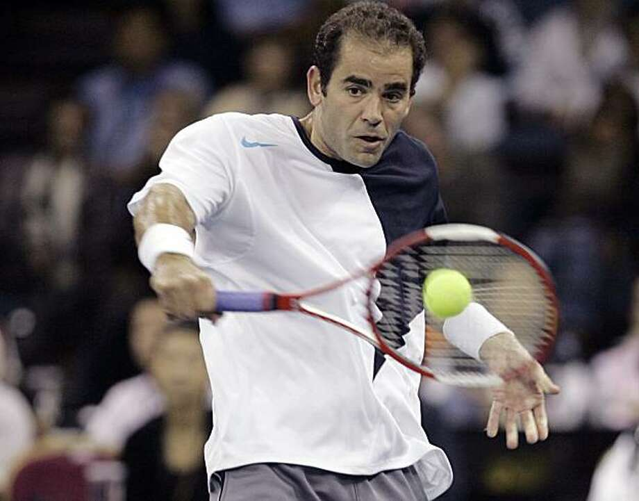 Pete Sampras of the United States returns the ball during a friendly match against Roger Federer of Switzerland in Macau Saturday, Nov. 24, 2007. Sampras won 7-6, 6-4. (AP Photo/Kin Cheung) Photo: Kin Cheung, AP