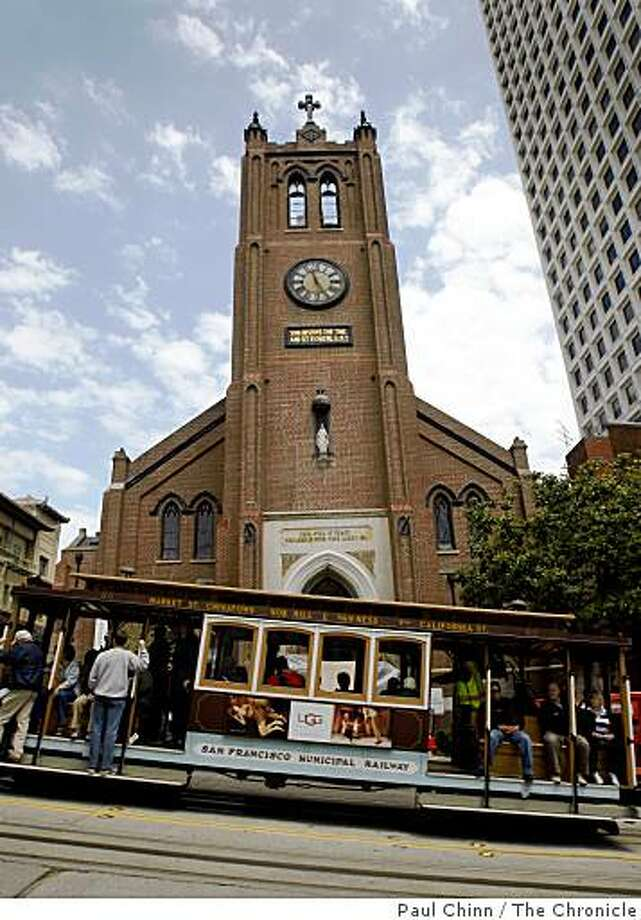 A California Street cable car rolls past Old Saint Mary's Cathedral in San Francisco. Photo: Paul Chinn, The Chronicle