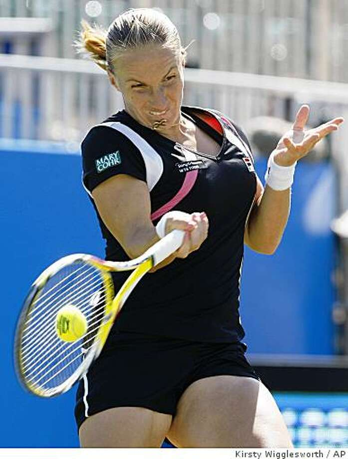 Svetlana Kuznetsova of Russia plays a return to Aleksandra Wozniak of Canada, during their Eastbourne grass court tournament singles tennis match in Eastbourne, England, Tuesday, June 16, 2009. Wozniak won by 6-0, 6-3.(AP Photo/Kirsty Wigglesworth) Photo: Kirsty Wigglesworth, AP