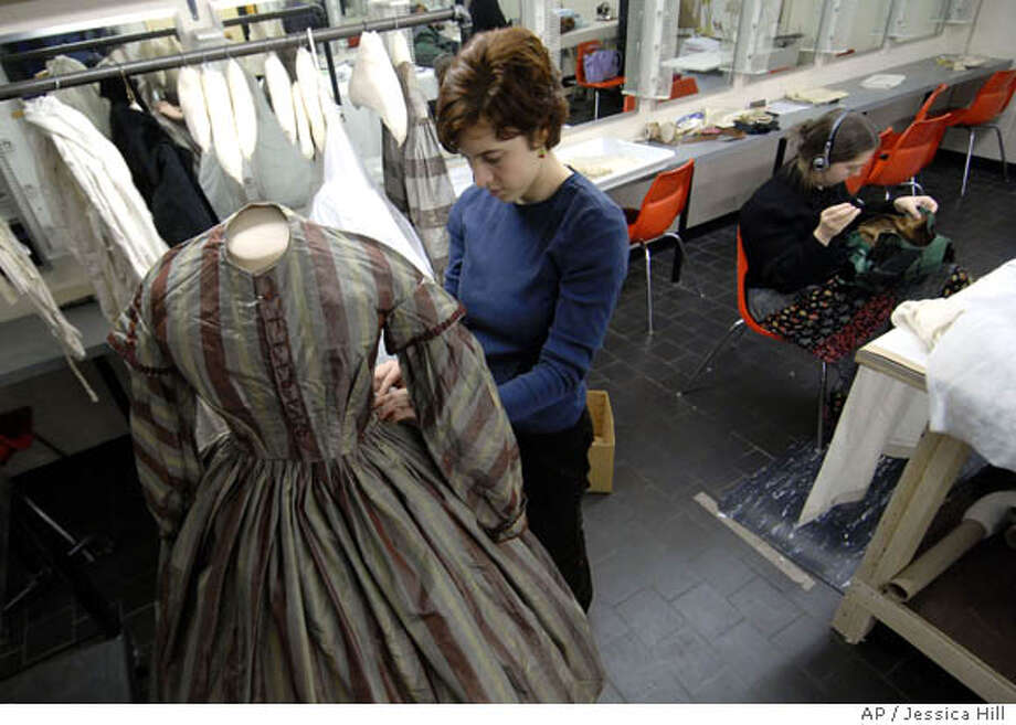 **APN ADVANCE FOR SUNDAY FEB.3** Emma Forrest of Somerville, Mass., left, pins a dress from the 1840's onto a mannequin as Miriam Roberts of Philadelphia, Penn., right, sews a bodice from the 1860's at Smith College in Northampton, Mass., Wednesday . Jan. 16, 2008. Forrest and Roberts are part of a class that is restoring and repairing garments in the college's collection of items that date back to the mid-1800s. (AP Photo/Jessica Hill) Photo: Jessica Hill