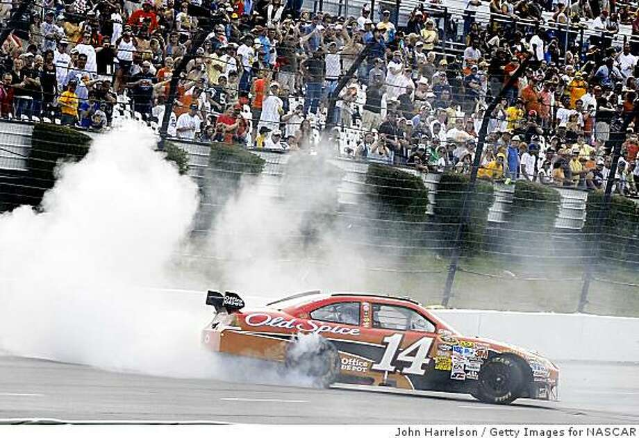 LONG POND, PA - JUNE 07:  Tony Stewart, driver of the #14 Office Depot/Old Spice Chevrolet does a burnout after winning the NASCAR Sprint Cup Series Pocono 500 on June 7, 2009 at Pocono Raceway in Long Pond, Pennsylvania.  (Photo by John Harrelson/Getty Images for NASCAR) Photo: John Harrelson, Getty Images For NASCAR