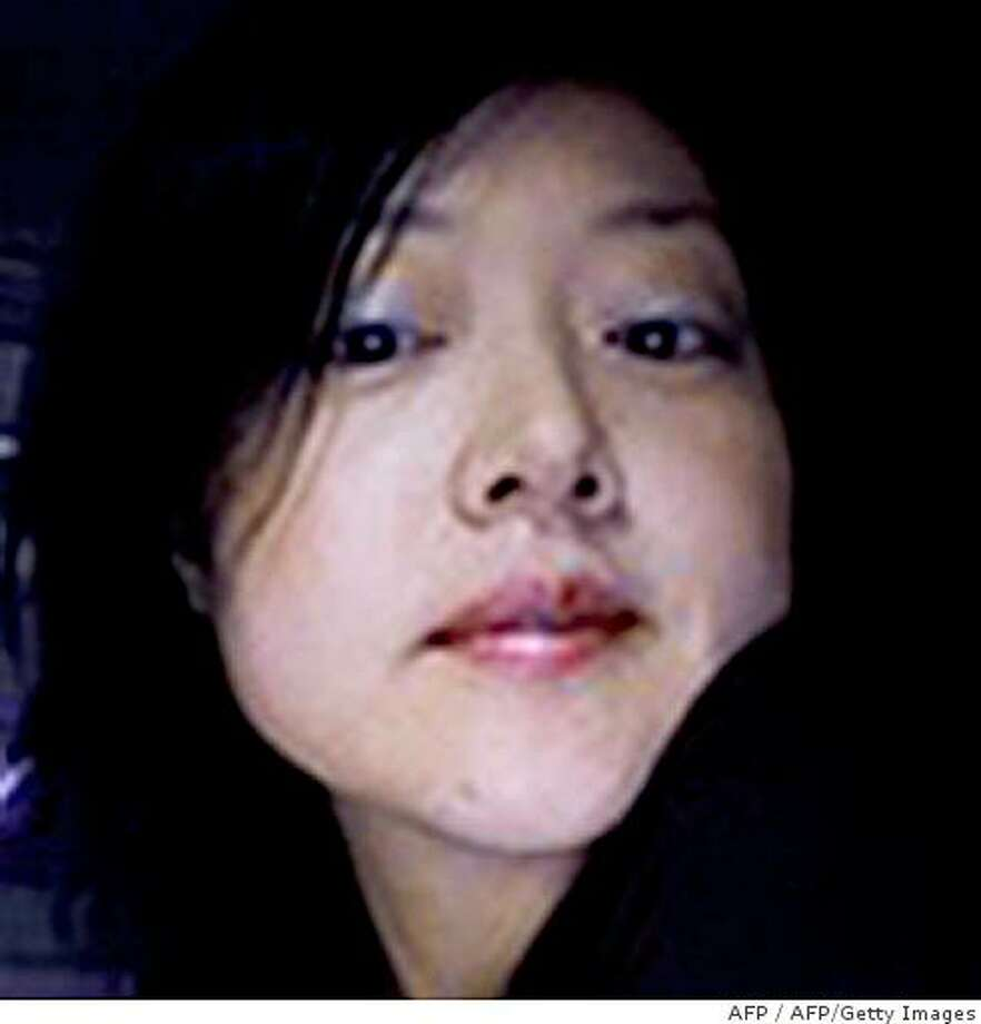 (FILES) This combo of file photos released by Yonhap news agency in Seoul on March 19, 2009 shows US journalists Euna Lee (L) and Laura Ling (R).  The two US women journalists will go on trial in North Korea's highest court on June 4, 2009 on charges that could send them to a labour camp, amid growing international tensions sparked by Pyongyang's nuclear test.    REPUBLIC OF KOREA OUT  NO INTERNET  NO SALES  NO ARCHIVES     AFP PHOTO / YONHAP (Photo credit should read AFP/AFP/Getty Images) Photo: AFP, AFP/Getty Images