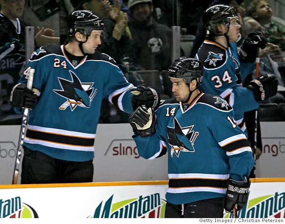 SAN JOSE, CA - FEBRUARY 09: Jonathan Cheechoo #14 of the San Jose Sharks is congratulated by teammate Sandis Ozolinsh #24 after scoring a first period goal against the Nashville Predators during the NHL game at HP Pavilion on February 9, 2008 in San Jose, California. (Photo by Christian Petersen/Getty Images) Photo: Christian Petersen