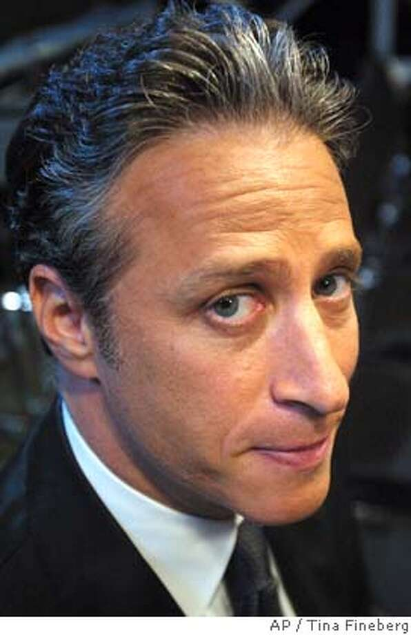 "**FILE**Comedian Jon Stewart poses on the set of Comedy Central's ""The Daily Show"" in New York, in this July 23, 2003, file photo. (AP Photo/Tina Fineberg) Ran on: 12-19-2004  Chris Daly  Ran on: 10-30-2006  Jon Stewart's &quo;Daily Show&quo; is at Ohio State Univer- sity to tape his &quo;Midwest Midterm Midtacular.&quo;  Ran on: 01-30-2008  Jon Stewart's goofy faces won't be enough to fill the time between commercials at the Academy Awards. Photo: TINA FINEBERG"