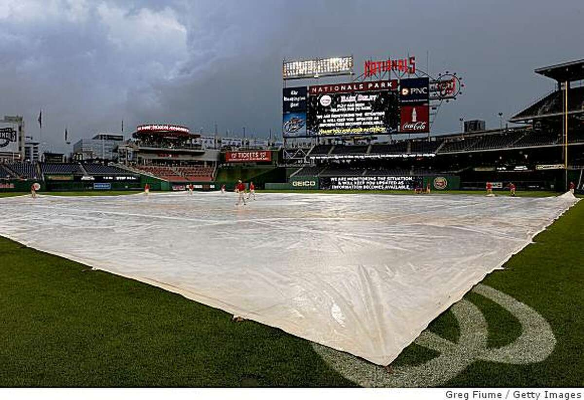 The field is covered during a rain delay of the game between the San Francisco Giants and the Washington Nationals at Nationals Park on June 3, 2009 in Washington, DC.