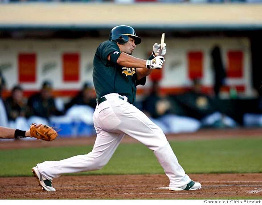 athletics_0270_cs.jpg Event on 7/2/07 in Oakland.  The Oakland A's Eric Chavez hits a broken bat single in the second inning as the A's play the Toronto Blue Jays at McAfee Coliseum in Oakland, California. At the end of the third inning, the A's trail 2-6. Photographed July 2, 2007.  Chris Stewart / San Francisco Chronicle Oakland A's, Toronto Blue Jays MANDATORY CREDIT FOR PHOTOG AND SF CHRONICLE/NO SALES-MAGS OUT Photo: Chris Stewart