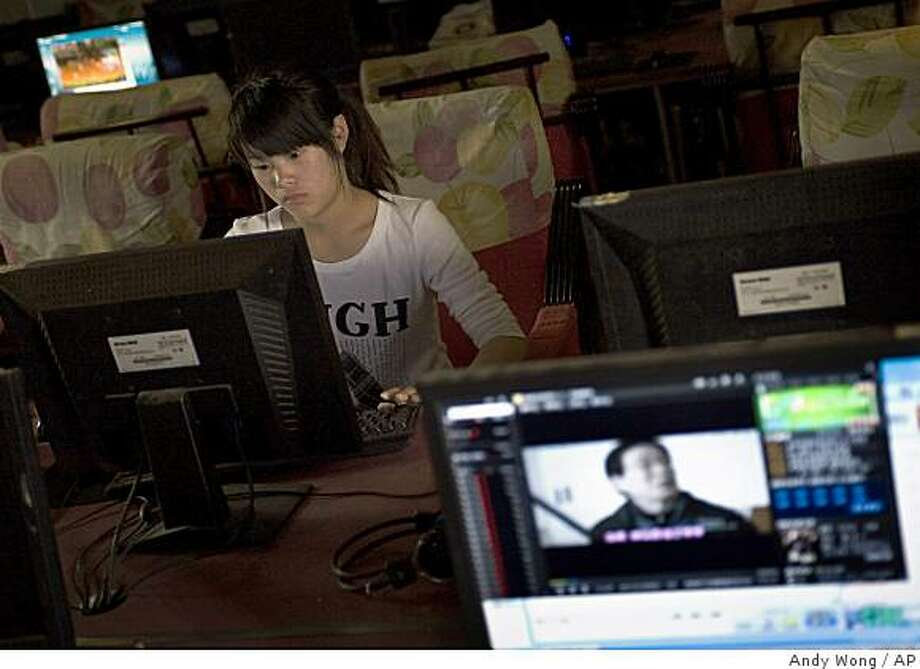 FILE - In this May 8, 2009 file photo, a Chinese girl surfs the Internet at a cyber cafe in Zhengzhou, Henan province, China.  China appeared to cave in to public pressure Tuesday, June 16, 2009, by announcing that computer users are not required to install Internet-filtering software, though it will still come with all PCs sold on the mainland. (AP Photo/Andy Wong, File) Photo: Andy Wong, AP