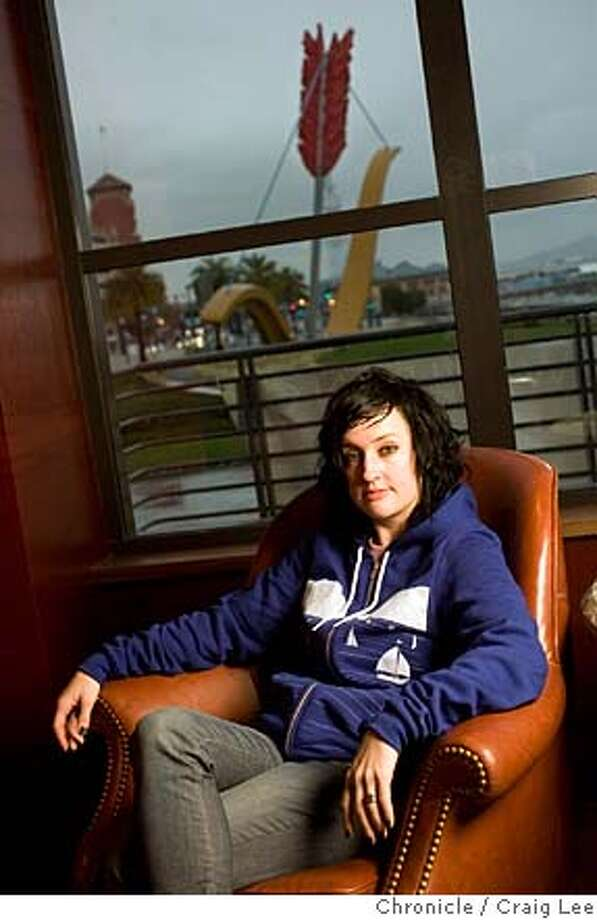 Camber Lay, bartender at a brand new restaurant called Epic Roadhouse at 369 Embarcadero. Camber Lay sitting in the bar lounge area of Epic Roadhouse with a view of the bow and arrow sculpture in the background.  photo by Craig Lee / The Chronicle MANDATORY CREDIT FOR PHOTOG AND SF CHRONICLE/NO SALES-MAGS OUT Photo: Photo By Craig Lee