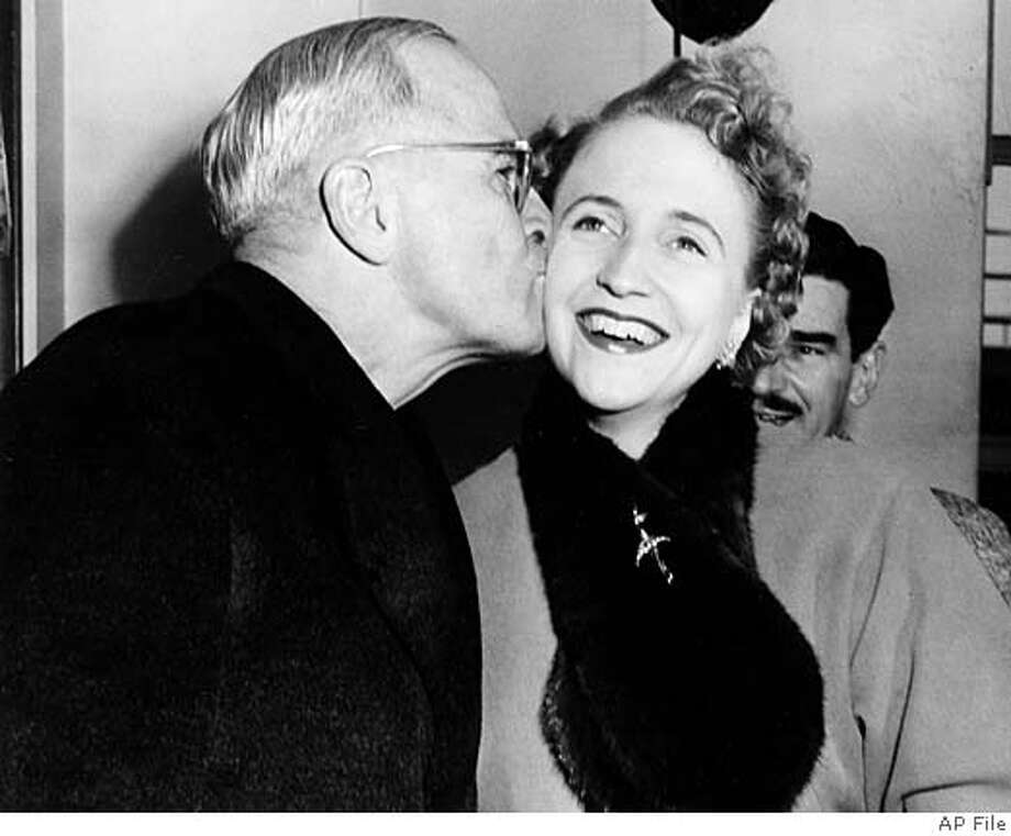 ** FILE ** Former President harry Truman kisses his daughter, Margaret, when she greeted him on arrival in New York to make a television appearance in this 1954 file photo. Margaret Truman, the only child of former President Harry S. Truman who became a concert singer, actress, radio and TV personality and mystery writer, died Tuesday, Jan 29, 2008. She was 83. (AP Photo/File)