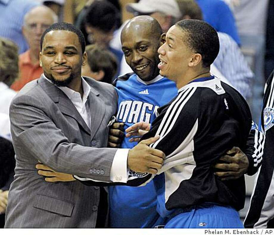 Orlando Magic guards Jameer Nelson, from left, Anthony Johnson and Tyronn Lue celebrate during the final seconds of the second half of Game 3 of the NBA Eastern Conference basketball finals against the Cleveland Cavaliers in Orlando, Fla., Sunday, May 24, 2009.  The Magic won 99-89. (AP Photo/Phelan M. Ebenhack) Photo: Phelan M. Ebenhack, AP