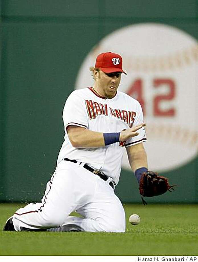 Washington Nationals left fielder Adam Dunn fails to make a catch on a double by New York Mets' David Wright during the second inning of a baseball game, Friday, June 5, 2009, in Washington. (AP Photo/Haraz N. Ghanbari) Photo: Haraz N. Ghanbari, AP