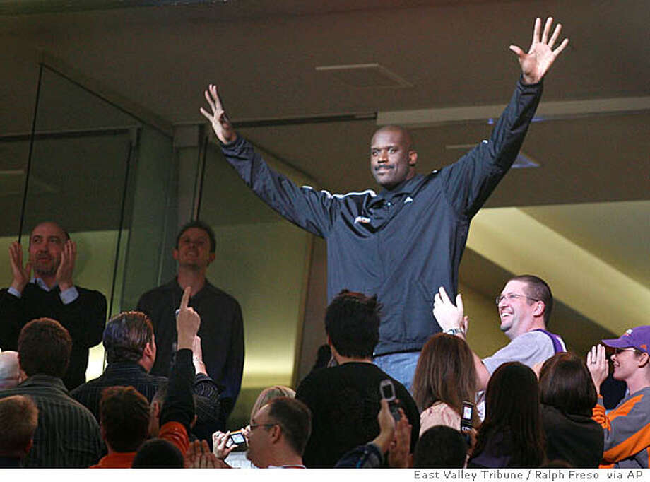 Phoenix Suns newly-acquired center Shaquille O'Neal acknowledges fans after being introduced as the Suns play against the New Orleans Hornets in an NBA basketball game, Wednesday, Feb, 6, 2008 in Phoenix. The Suns acquired O'Neal in a stunning, blockbuster deal that sent four-time All-Star Shawn Marion and Marcus Banks to the Miami Heat on Wednesday. (AP Photo/ East Valley Tribune / Ralph Freso Photo: Ralph Freso