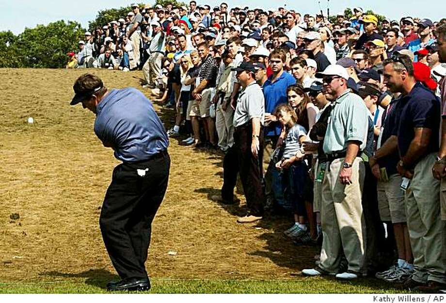 Phil Mickelson hits from under the fifth hole as the gallery looks on during the final round of the U.S. Open Golf Championship at the Black Course of Bethpage State Park in Farmingdale, N.Y., Sunday, June 16, 2002. (AP Photo/Kathy Willens) Photo: Kathy Willens, AP