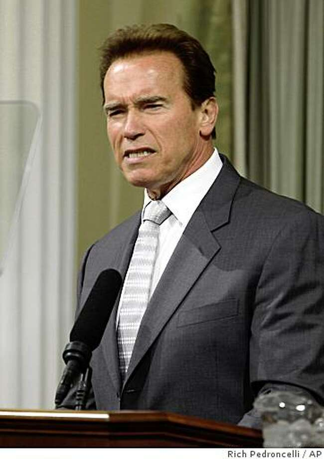 Gov. Arnold Schwarzengger grimaces as he discusses the state's $24.3 billion budget deficit during a joint session of the Legislature at the Capitol  in Sacramento, Calif., Tuesday, June 2, 2009.(AP Photo/Rich Pedroncelli) Photo: Rich Pedroncelli, AP