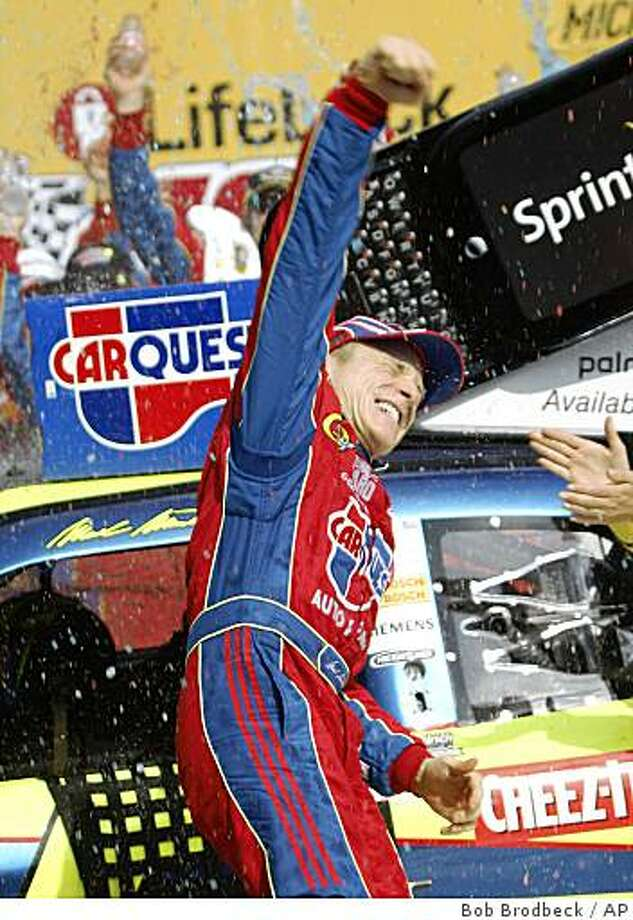 Mark Martin (5) celebrates his victory in the NASCAR LifeLock 400 race at Michigan International Speedway in Brooklyn, Mich., Sunday, June 14, 2009. (AP Photo/Bob Brodbeck) Photo: Bob Brodbeck, AP