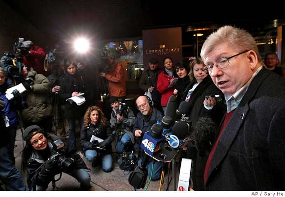 Writers Guild of America East president Michael Winship, right, makes a statement to the media prior to a membership meeting to discuss the latest contract proposal, Saturday, Feb. 9, 2008 in New York. (AP Photo/Gary He) Photo: GARY HE
