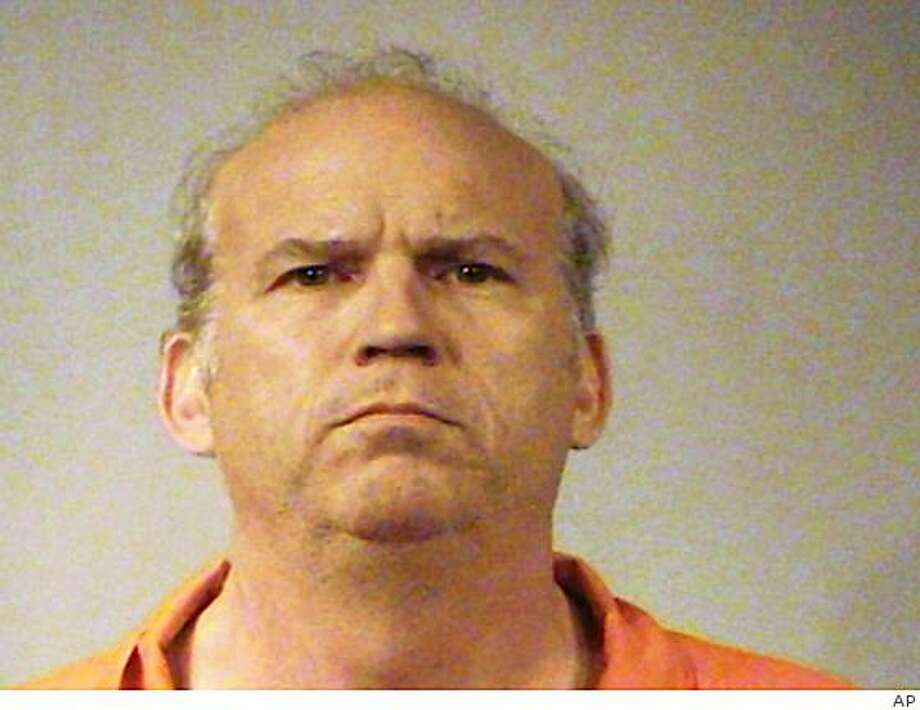 This undated booking photo released Tuesday, June 2, 2009 by the Sedgwick County Jail shows Scott Roeder, 51, who made his first court appearance Tuesday in Sedgwick County District Court in Wichita, Kan.  Roeder was charged Tuesday with first-degree murder in the death of late-term abortion provider Dr. George Tiller, asking the judge by video when he would see his court-appointed lawyer. (AP Photo/Sedgwick County Jail) Photo: AP