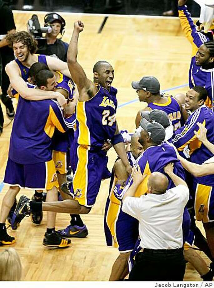 Los Angeles Lakers' Kobe Bryant (24) and teammates celebrate after deafeating the Orlando Magic 99-86 during Game 5 of the NBA basketball finals Sunday, June 14, 2009, in Orlando, Fla. (AP Photo/Orlando Sentinel, Jacob Langston) ** LEESBURG OUT  LADY LAKE OUT  DAYTONA BEACH OUT  MAGS OUT  NO SALES  TV OUT ** Photo: Jacob Langston, AP