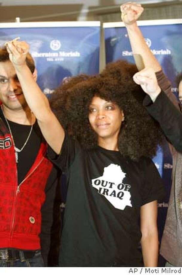 Grammy-award winning neo-soul vocalist Erykah Badu, center, gestures during a press conference at a Tel Aviv hotel Thursday Jan. 31, 2008. Badu is scheduled to perform in Tel Aviv on Saturday night. (AP Photo/Moti Milrod) Photo: MOTI MILROD
