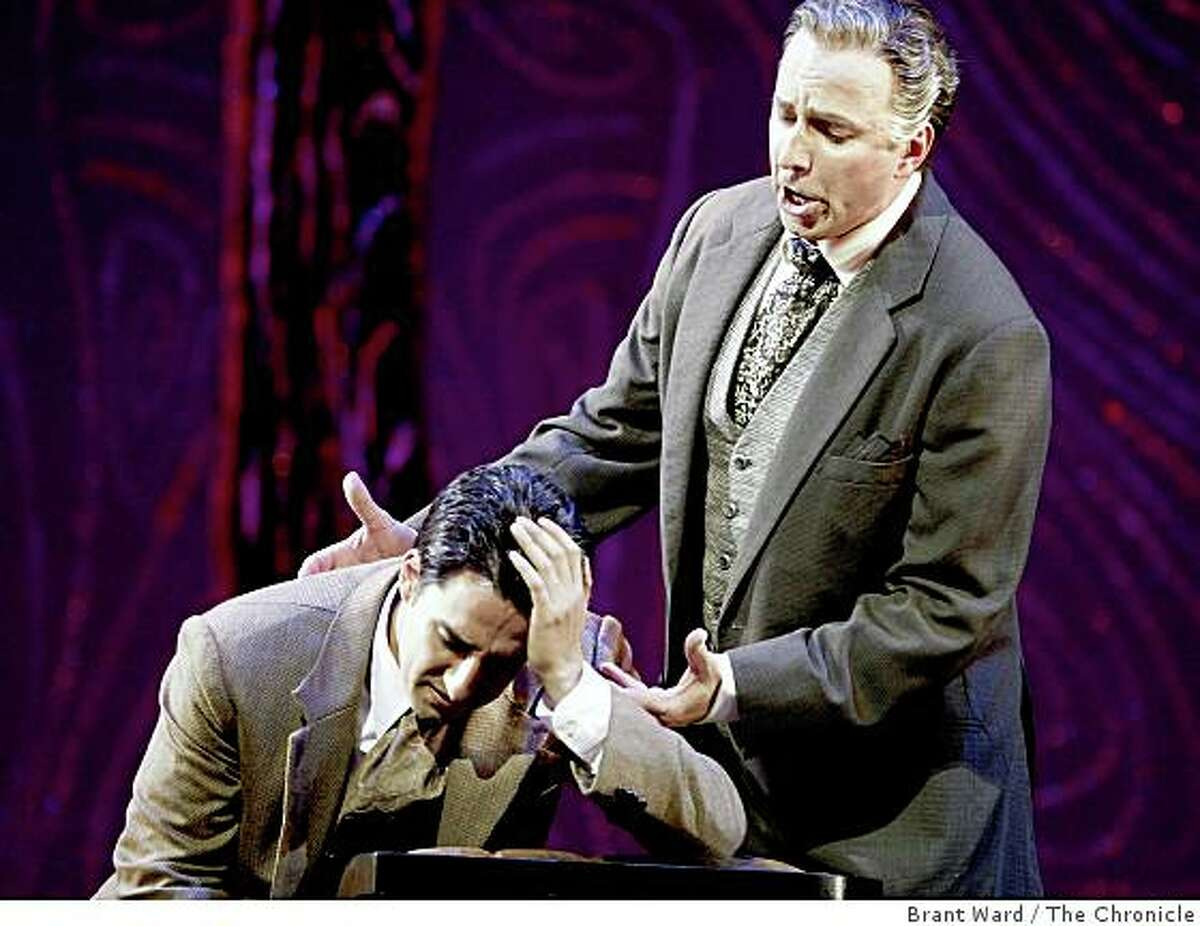 """Dwayne Croft as Alfredo's father (right) talks to his son about his love leaving him in the second Act. San Francisco opera concludes their summer season with Verdi's """"La Traviata"""" at the War Memorial Opera House."""