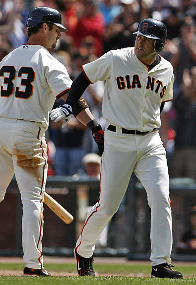Giants Aaron Rowand (left)  congratulates Rich Aurilia as he crosses homeplate after making a homerun and giving the Giants a one run lead in the seventh inning against the St. Louis Cardinals,  Sunday May 31, 2009, in San Francisco, Calif. Photo: Lacy Atkins, The Chronicle