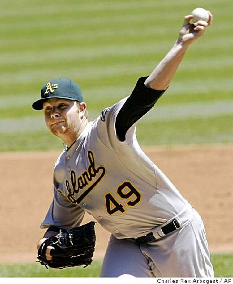 Oakland Athletics starting pitcher Brett Anderson delivers during the first inning of a baseball game against the Chicago White Sox, Thursday, June 4, 2009, in Chicago. (AP Photo/Charles Rex Arbogast) Photo: Charles Rex Arbogast, AP
