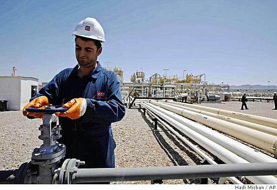 An employee works at Tawke oil fields in the semiautonomous Kurdish region in northern Iraq on Sunday, May 31, 2009. Iraq's self-ruled Kurdish region began officially pumping crude oil to the international market for the first time Monday June 1, 2009, a move that will boost Iraq's thin budget. Photo: Hadi Mizban, AP
