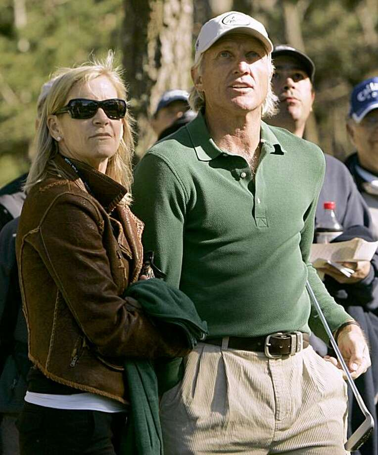 Australian golfer Greg Norman and his fiance, former tennis star Chris Evert, watch a shot by Norman's son Gregory at the 15th hole during the first round of the Pebble Beach National Pro-Am golf tournament at Poppy Hills Golf Club in Pebble Beach, California February 7, 2008. REUTERS/Robert Galbraith (UNITED STATES) Photo: ROBERT GALBRAITH, REUTERS