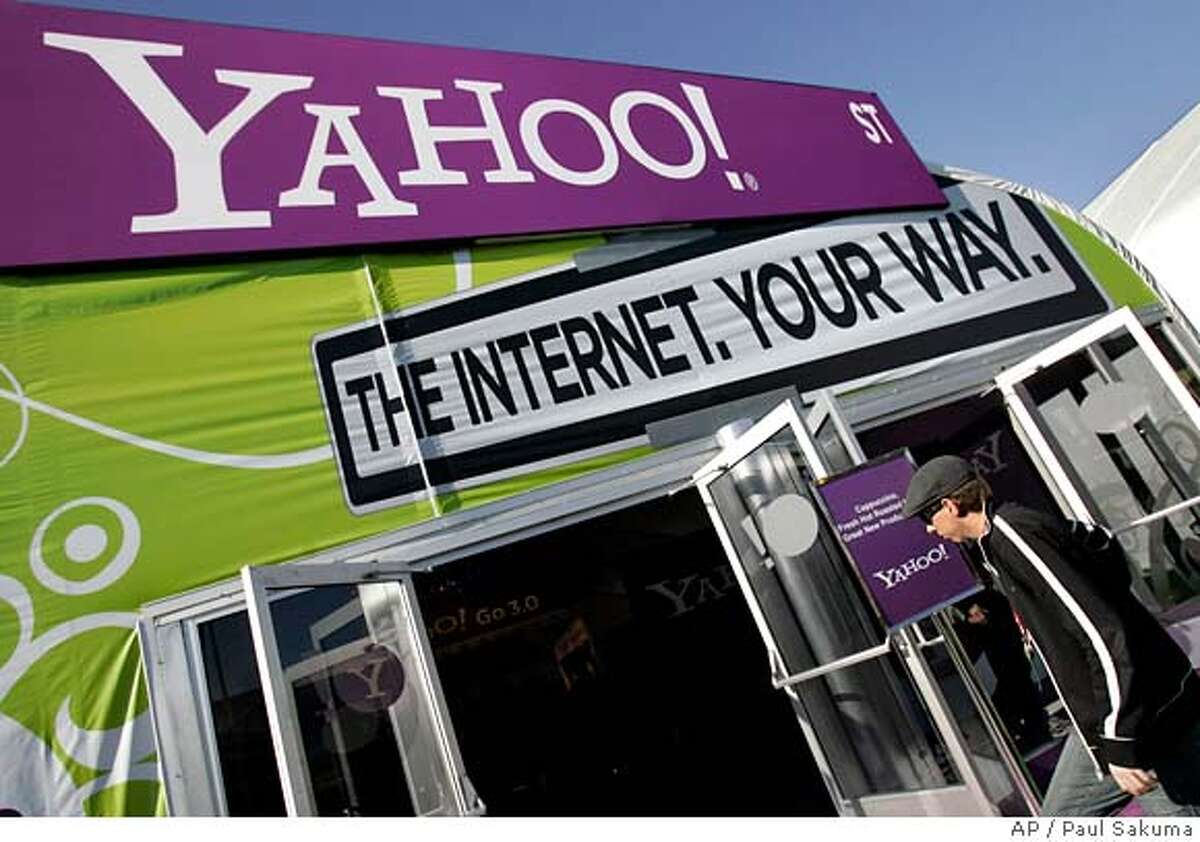 ** FILE ** The Yahoo tent at the Consumer Electronics Show (CES) is seen in Las Vegas in this Jan. 7, 2008 file photo. Yahoo Inc.'s board reportedly called a special meeting Friday to discuss the slumping Internet pioneer's first response to Microsoft Corp.'s week-old takeover bid, setting the stage for a quick resolution or months of acrimonious wrangling. (AP Photo/Paul Sakuma, file) JAN 7, 2007 PHOTO. NOT A FILE