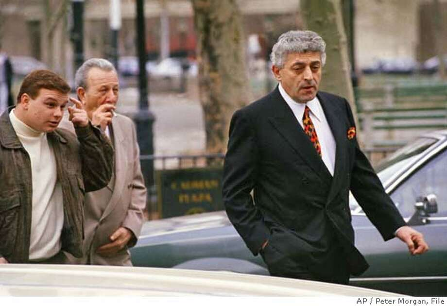 """**FILE** John """"Jackie Nose"""" D'Amico, right, arrives at Brooklyn's Federal Courthouse in Brooklyn, in this file photo from March 6, 1992, for continued testimony in the John Gotti case. Other men are not identified. D'Amico, the reputed acting boss of the Gambino crime family, was named in a federal indictment which charges dozens of reputed members of the Gambino crime family with murders, drug trafficking, robberies, extortion, and other crimes dating back to the 1970s, authorities said Thursday, Feb. 7, 2008. (AP Photo/Peter Morgan, File) 1992 FILE PHOTO Photo: Peter Morgan"""