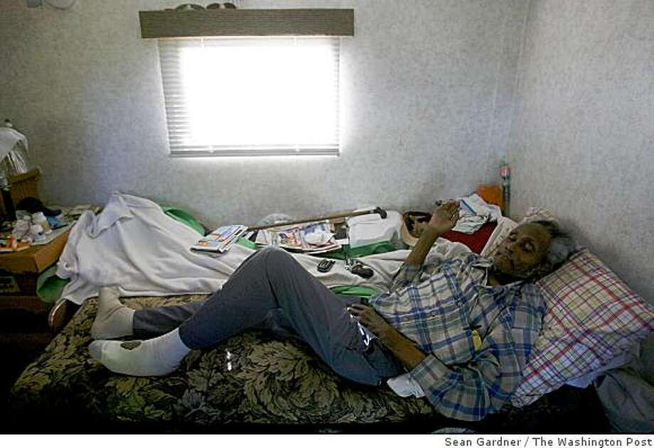 James Johnson, 74, listens to talk radio in his FEMA trailer in Gulfport, Miss. He keeps his gun close by for protection. Johnson and thousands of others displaced nearly four years ago by Hurricane Katrina face renewed uncertainty this summer about where they will live. Illustrates KATRINA-HOUSING (category a), by Spencer S. Hsu (c) 2009, The Washington Post. Moved Saturday, June 13, 2009. (MUST CREDIT: photo for The Washington Post by Sean Gardner.) Photo: Sean Gardner, The Washington Post