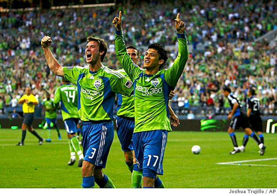 Seattle Sounders player Brad Evans (3) celebrates with teammate Fredy Montero (17) after Montero's second half goal against the San Jose Earthquakes in an MLS soccer game  on Saturday June 13, 2009 at Qwest Field in Seattle.  (AP Photo/Seattlepi.com, Joshua Trujillo)  ** **MANDATORY CREDIT**  SEATTLE TIMES OUT, MAGS OUT, NO SALES  * Photo: Joshua Trujillo, AP