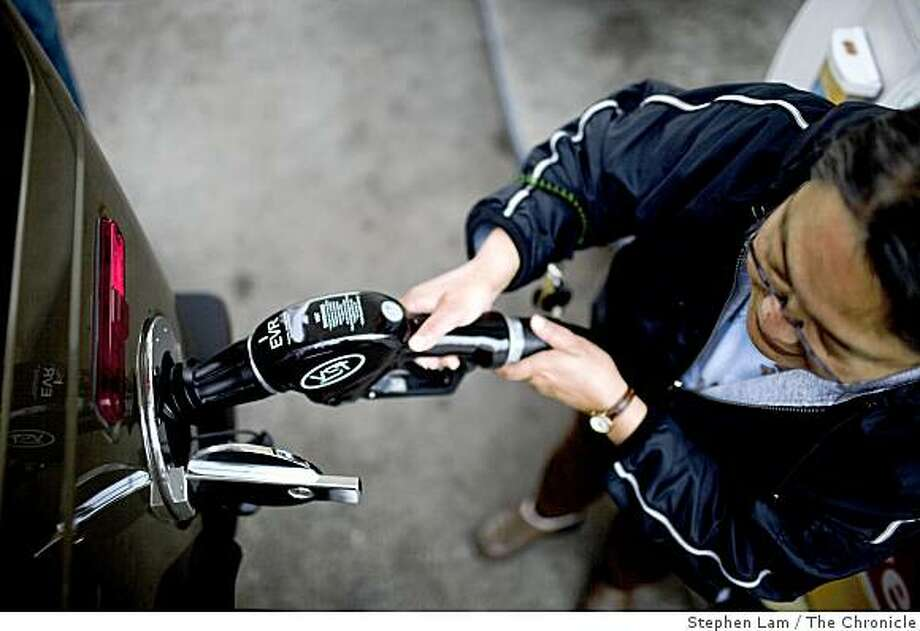 Bobbie Certeza, of San Francisco refuels her family Hummer H2 SUV at the Shell gas station along Lombard street in San Francisco, Calif. on Monday, June 15, 2009. California's average price for a gallon of gas is set to raise to about three dollars as oil traders are bidding up the price of petroleum, betting that the global economy will start clawing its way out of recession later this year. Photo: Stephen Lam, The Chronicle